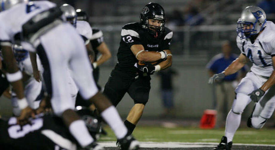 Pearland fullback Josh Gonzales splits the Brazoswood defense in the first half at the Rig. Gonzales took over the bulk of the running duties when the Oilers' leading rusher left the game with an ankle injury. Photo: Thomas Shea, For The Chronicle