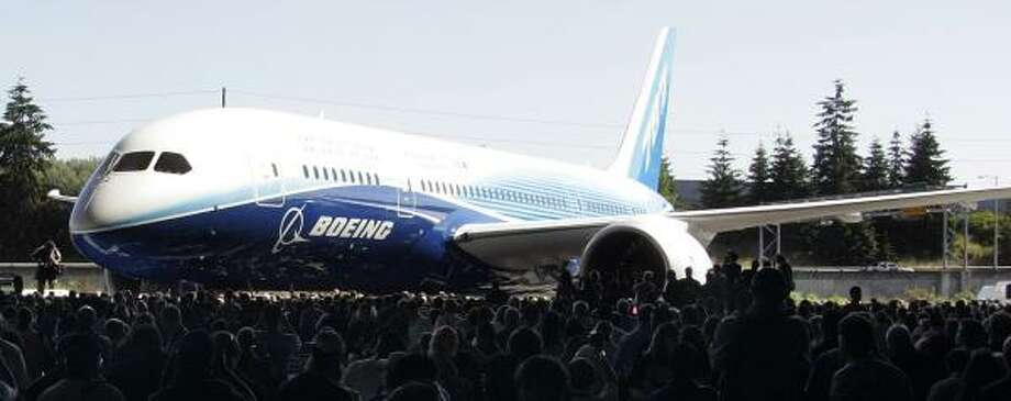 Boeing workers welcome the first 787 Dreamliner aircraft in Everett, Wash., in July. Delivery of the first new American commercial jetliner in more than a decade has been pushed back at least six months. Photo: TANGI QUEMENER, AFP/GETTY IMAGES FILE