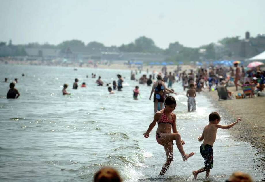 People try to beat the heat at Jennings Beach in Fairfield, Conn. Thursday, July 21, 2011. Photo: Autumn Driscoll / Connecticut Post