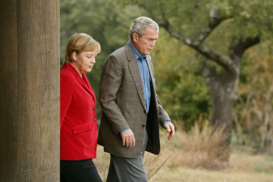President Bush and German Chancellor Angela Merkel toured his ranch in Crawford today. Photo: Gerald Herbert, Associated Press
