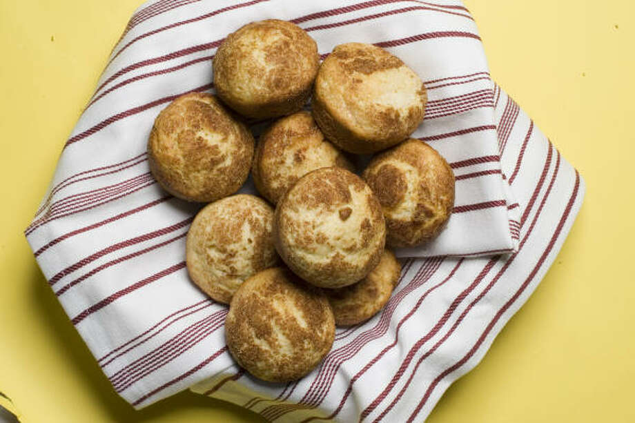 YOU WON'T MISS THE HOLES:Oven-baked doughnuts are easily made in muffin tins. Photo: Buster Dean, Chronicle