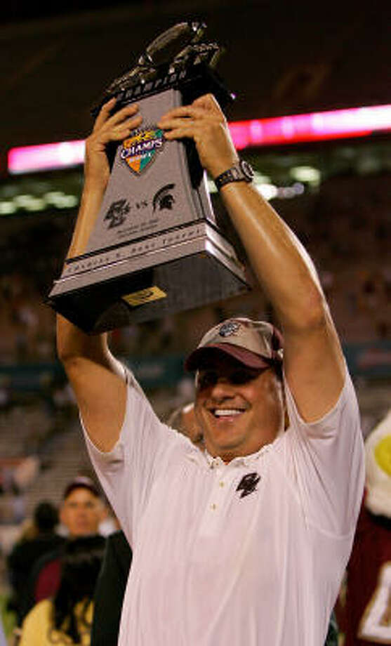 Boston College coach Jeff Jagodzinski hoists the trophy after winning the Champs Bowl against the Michigan State Spartans at the Citrus Bowl. Photo: Sam Greenwood, Getty Images