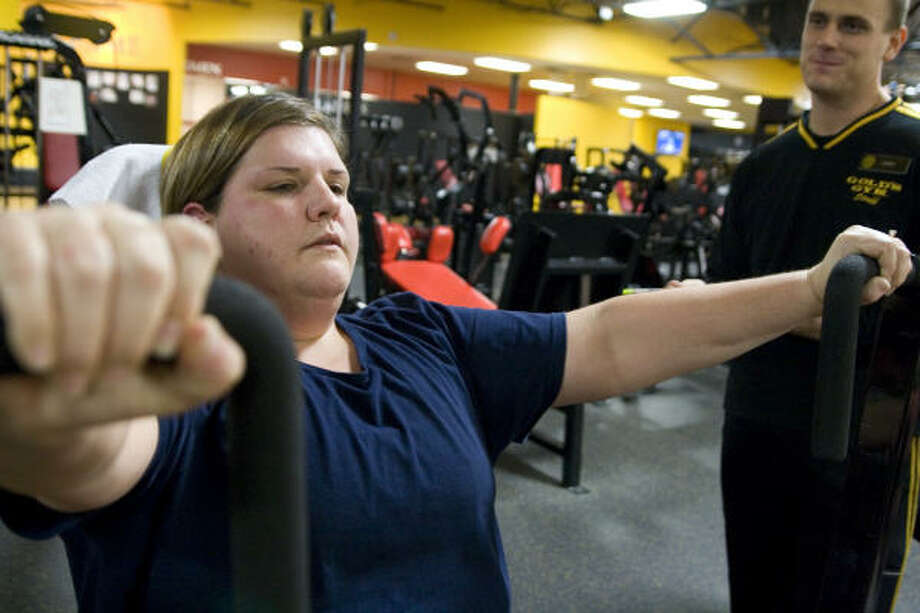 Sara Knetsar works out hard with Gold's Gym personal trainer Cory Wiatrek, participating in a 12-week body transformation challenge. Photo: Kenzie DelaTorre, For The Chronicle