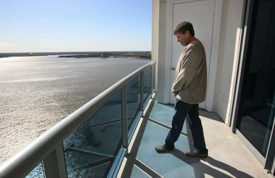 Robin Parsley, founding partner of the Endeavour Clear Lake, takes in the view at the condos on NASA Parkway. Photo: MAYRA BELTRÁN, CHRONICLE