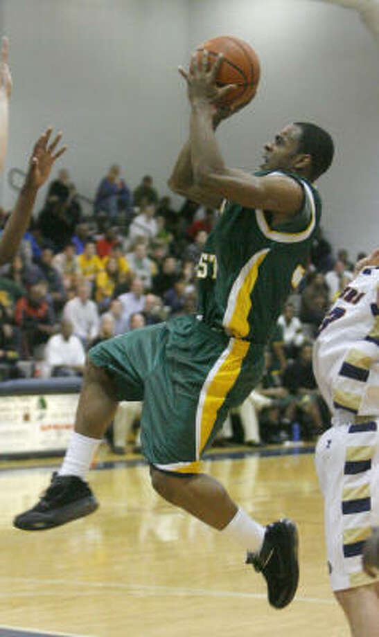 Klein Forest guard Chris Hines (pictured) said if a game comes down to a last-second shot, he is 100 percent confident any teammate will get the job done. Photo: Steve Campbell, Chronicle