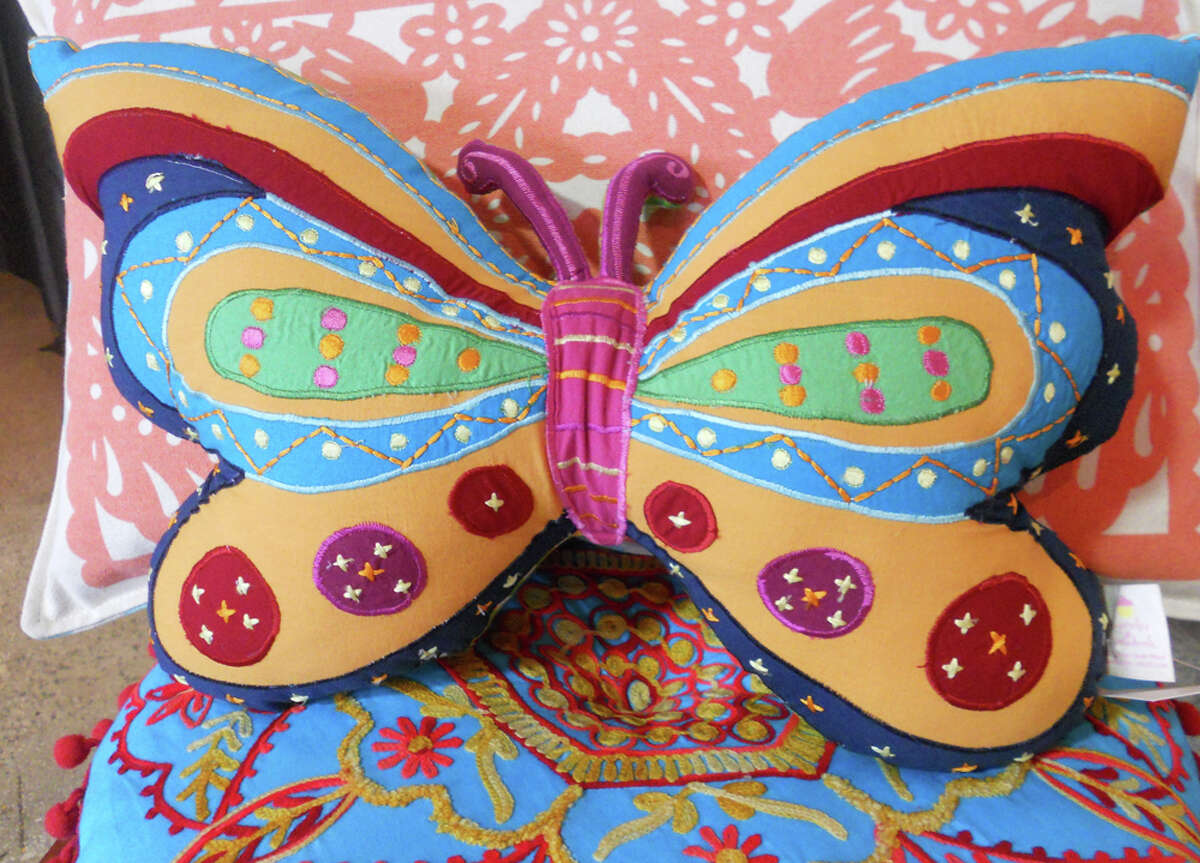 303 Pearl Parkway Suite 107: Butterfly pillow by Cupcakes and Cartwheels, $31, is available at Adelante.