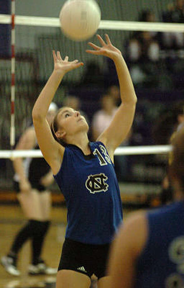 New Caney's Megan Gothard sets the ball during the Montgomery Varsity Volleyball Tournament in August. Photo: David Hopper, For The Chronicle