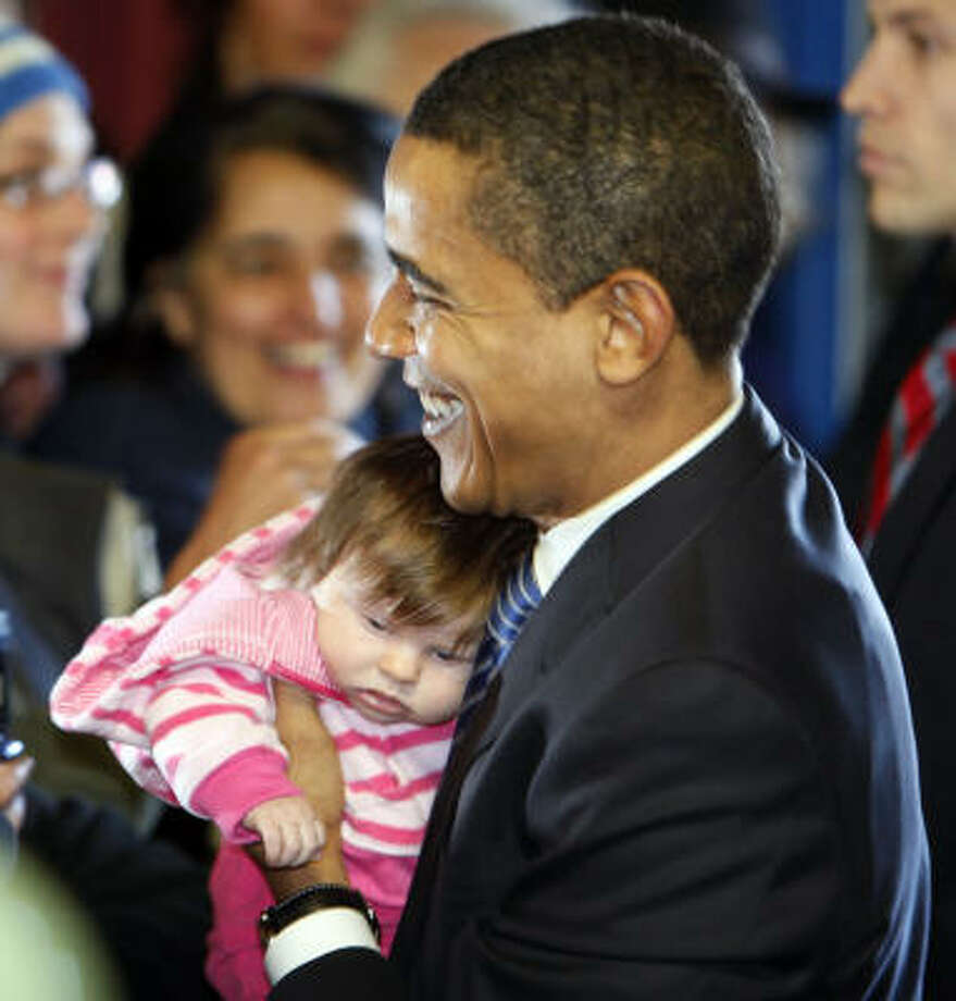 A baby seems to be getting a head start on naptime despite meeting Democratic presidential hopeful Barack Obama before he takes the stage in Medford, Ore., on Saturday. Photo: Alex Brandon, Associated Press