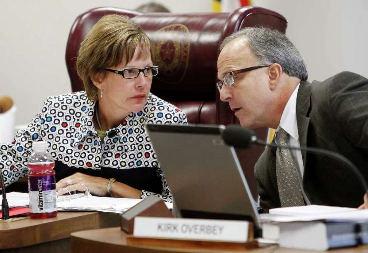 Texas Board of Education Chair Barbara Cargill, left, and board member Kirk Overbey, right, talk during a Texas Board of Education meeting, Thursday, July 21, 2011, in Austin, Texas. (AP Photo/Eric Gay)
