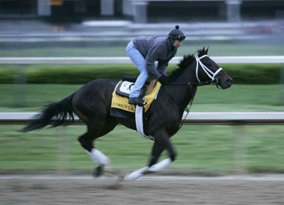 Kentucky Derby entry Cowboy Cal ridden by exercise rider Patty Krotenko works out at Churchill Downs on Thursday, May 1. Photo: Ed Reinke, AP