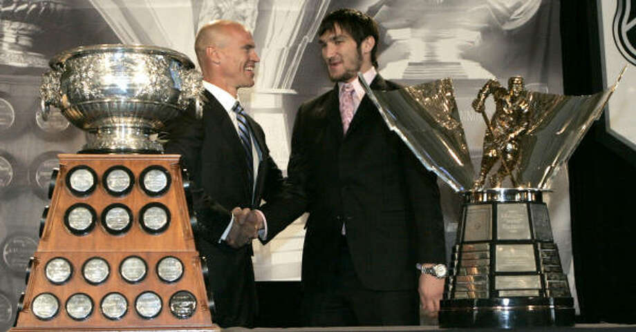 Washington's Alex Ovechkin picked up the Art Ross and Maurice Richard trophies in Pittsburgh. Photo: Keith Srakocic, AP