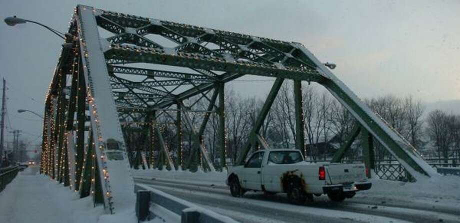 The Bridge Street bridge in Seneca Falls, N.Y., is believed by many there to be the inspiration for the fictional Bedford Falls in Frank Capra's movie classic It's a Wonderful Life. Photo: STEPHEN D. CANNERELLI, NEWHOUSE NEWS SERVICE