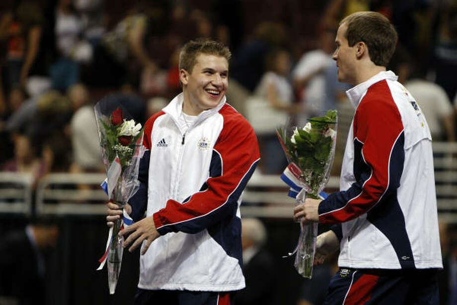 Houston's Jonathan Horton, left, and Paul Hamm were all smiles after being named to the U.S. Olympics Gymnastics men's team. Photo: Nick Laham, Getty Images