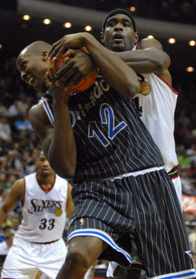 Chris Webber, rear, never seems to tire of wrestling with the likes of Orlando's Dwight Howard. Photo: Phelan M. Ebenhack, AP