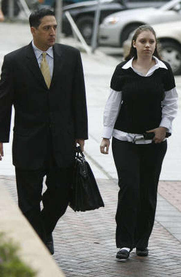 Lawyer Rick DeToto and his client Ashley Benton walk to the Harris County Criminal Justice Center this morning before her indictment. Photo: Mayra Beltran, Chronicle