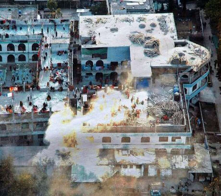 A photo released by Pakistan's government shows the Red Mosque during the raid ordered by President Pervez Musharraf. The assault has ignited a surge in suicide bombings. Photo: INTER SERVICES PUBLIC RELATIONS, HANDOUT PHOTO