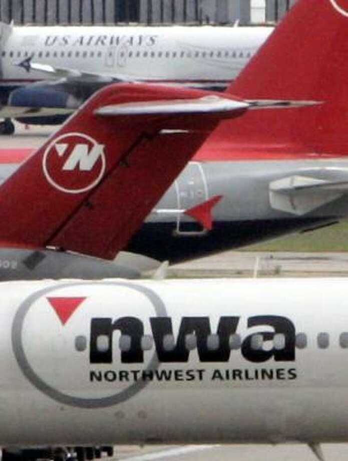 A Northwest jet taxis toward a gate at Detroit Metropolitan Airport. Photo: CARLOS OSORIO, ASSOCIATED PRESS FILE