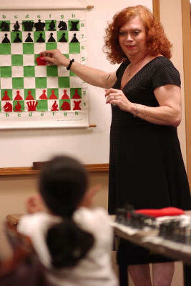 Debbie Berube provides instruction to children of Space City Chess Club members during one of their weekly meetings at the Gilruth Center on the campus of the Johnson Space Center. Photo: Ronnie Montgomery, For The Chronicle