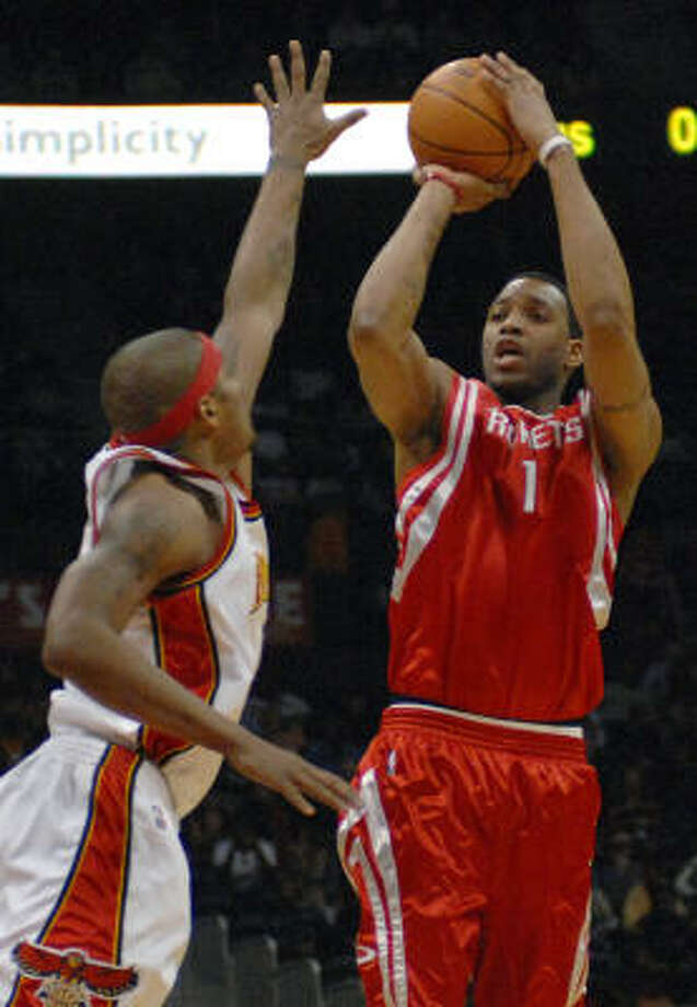 Tracy McGrady had 37 points for the Rockets in the team's 20th loss of the season. Photo: Gregory Smith, AP