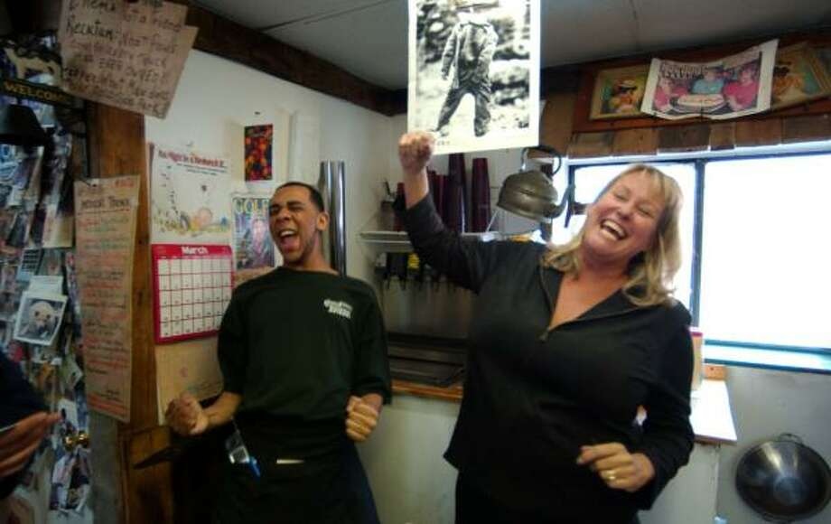 """""""Hillbilly"""" isn't a fighting word at Hillbilly Hotdogs in Huntington, W.Va., where Chris Shanklin, left, serves dogs for owner Sharie Knight, who has turned the stereotype into a celebration. Photo: JEFF GENTNER, ASSOCIATED PRESS"""
