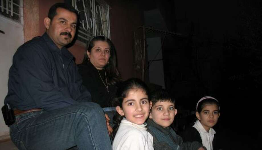 Abdul Salam Alwan, left, fled Iraq with wife Sally Abdul Hamid, and, from bottom left, daughter Sara, son Yousef and daughter Tayseer. Photo: GREGORY KATZ, CHRONICLE