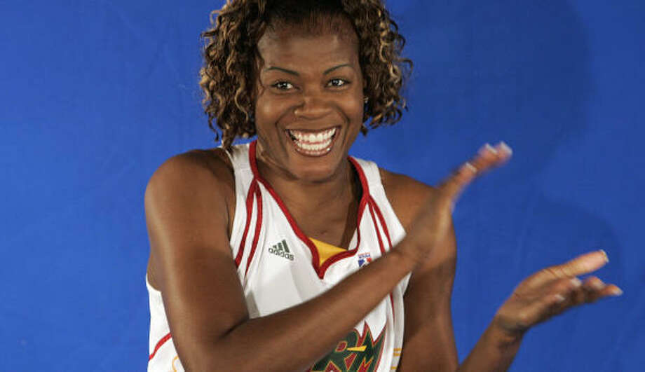 Unlike the Sonics, Sheryl Swoopes (shown filming a team video) and the Storm are staying in Seattle. Photo: Elaine Thompson, AP
