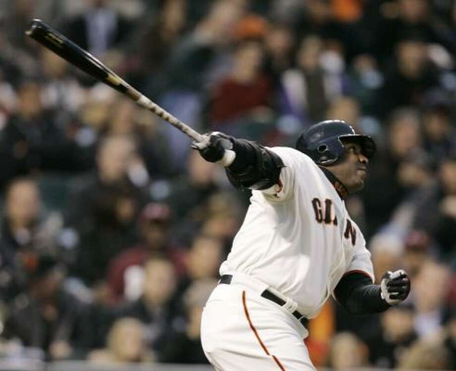 Barry Bonds connects on his first home run of the season and the 735th of his career, 20 shy of Hank Aaron's record. Photo: ERIC RISBERG, ASSOCIATED PRESS