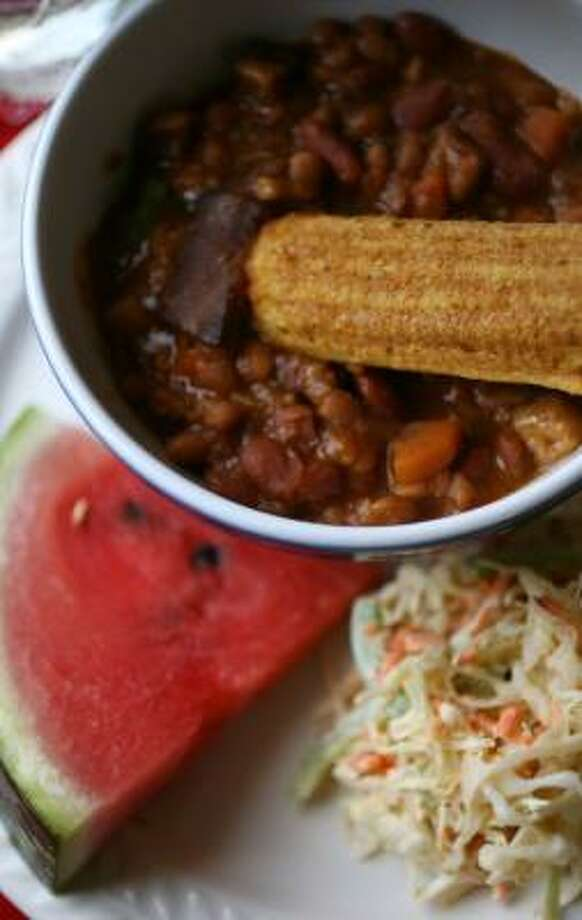 Menu 2:Spicy Baked Beans, Cornbread Sticks, Creamy Coleslaw and Watermelon Photo: SHARON STEINMANN, CHRONICLE