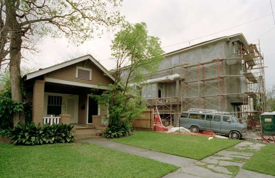 An oversized townhouse goes up next to a Montrose bungalow. Photo: CHRONICLE