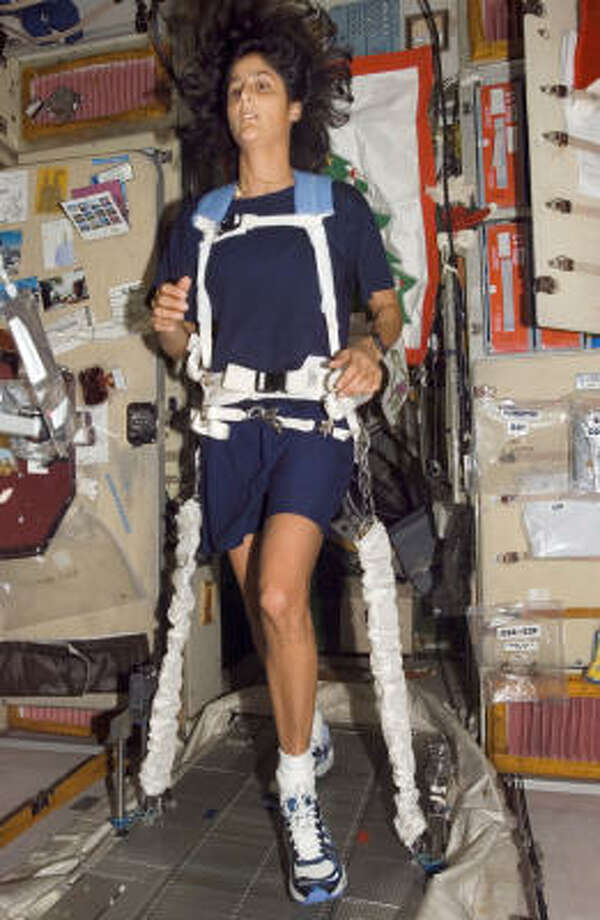 This file photo provided by NASA shows astronaut Sunita L. Williams tethered as she runs on a treadmill system aboard the international space station this past December. Photo: AP