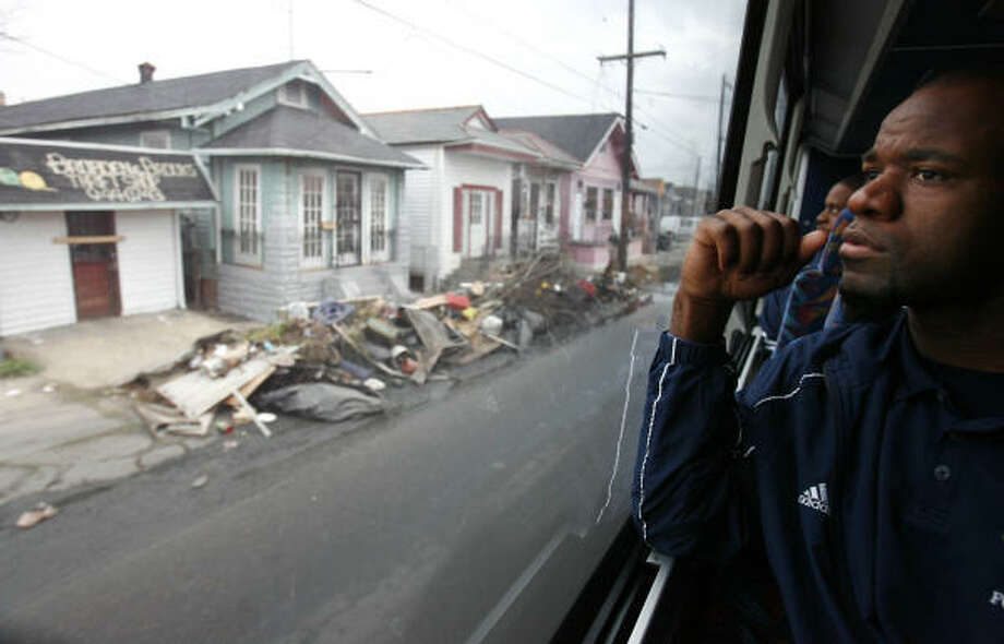"Rice linebacker Marcus Rucker looks at the destruction in the 9th Ward during a bus tour Wednesday. ""Every American should see this,"" his coach, Todd Graham, said. Photo: Sharon Steinmann, Chronicle"