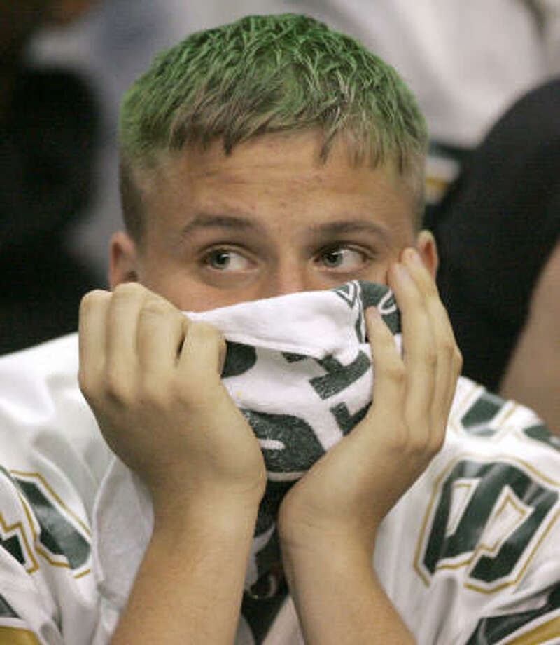 Cypress Falls student Cody Karisch watches the final minutes of the Class 5A Division II final. Cy Falls will be graduating 64 seniors from its team. Photo: BRETT COOMER, CHRONICLE