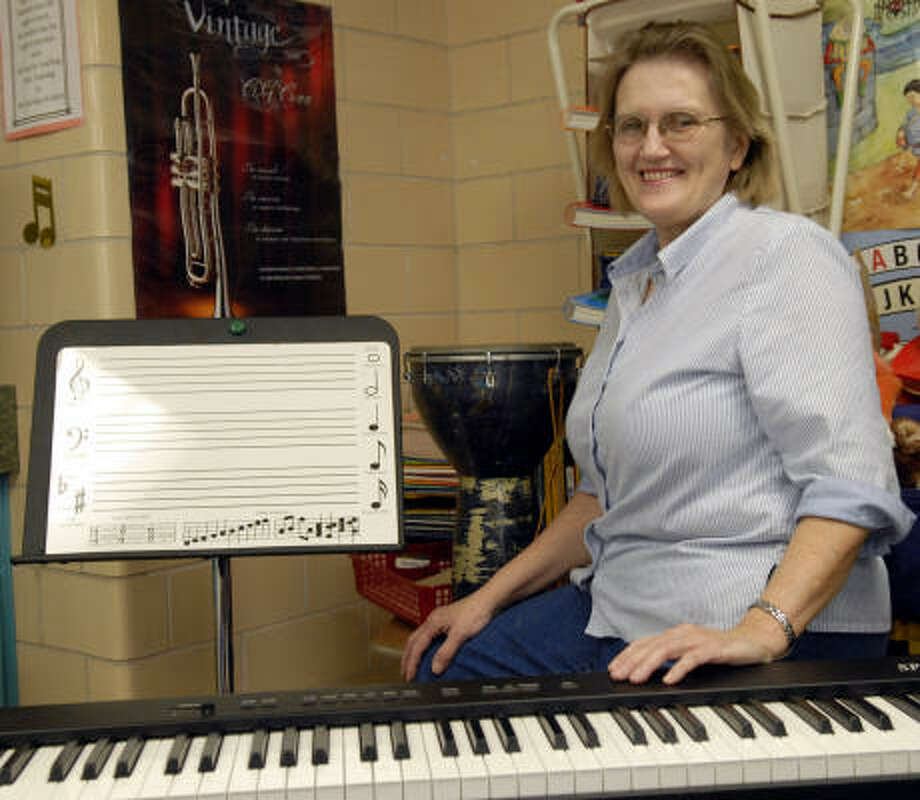 Stewart Elementary School music teacher Terry Laubscher poses in her room at the school. Photo: Kim Christensen, For The Chronicle