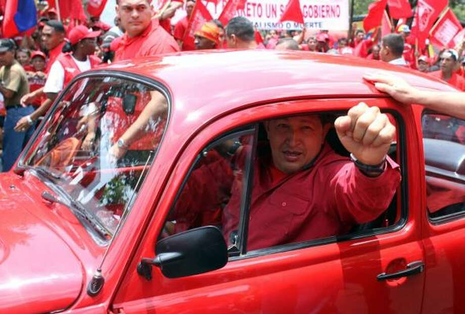 Venezuela President Hugo Chavez has recently led the charge to form the United Socialist Party of Venezuela, which would be made up of 24 political parties in his governing coalition. Photo: PRESIDENCIA PHOTOS, AFP/GETTY IMAGES