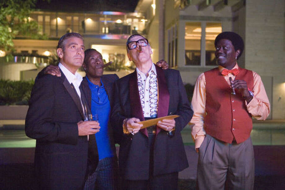 All the stars of Ocean's 13, except for George Clooney, who has his own tailor, were outfitted by Ike Behar. In style, from left, are Clooney, Don Cheadle, Elliott Gould and Bernie Mac. Photo: Melinda Sue Gordon, Warner Bros. Pictures
