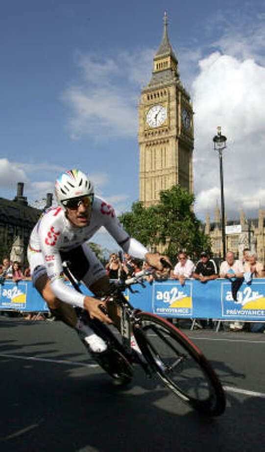 Swiss rider Fabian Cancellara, who clocked the fastest time in prologue, passes in front of St Stephens Tower and Big Ben in London Photo: TOM HEVEZI, AP