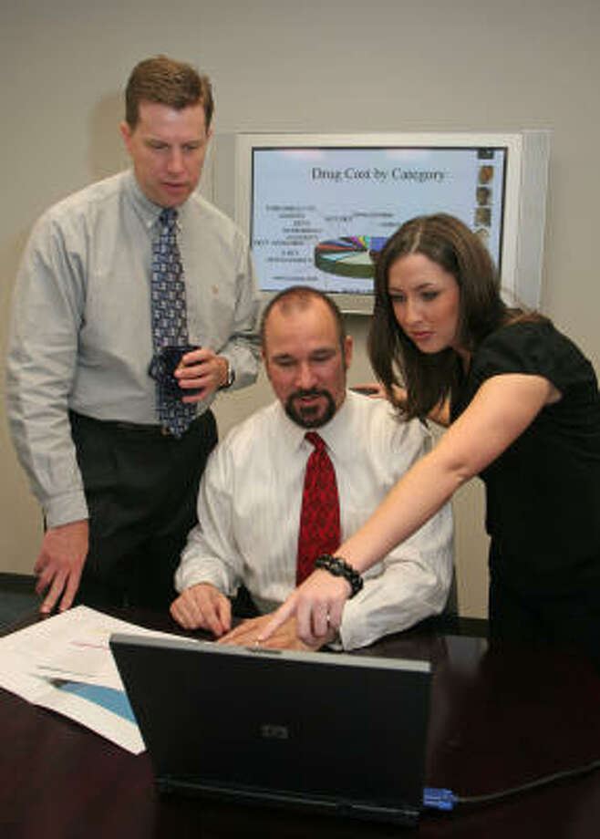 Dave Copeland, director of business development, from left, President Terry Andrus and marketing coordinator Lauren Crawford review a file at CompleteRx. Photo: Gary Fountain, For The Chronicle