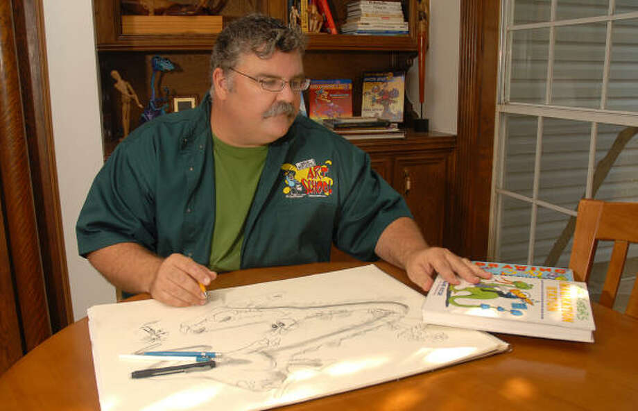 Children's illustrator Mark Kistler draws at a table in his home in Tomball. He will begin teaching weekly art classes Oct. 20 in The Woodlands. Photo: David Hopper, For The Chronicle