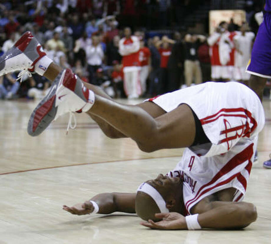 Houston Rockets guard/forward Bonzi Wells takes a tumble after losing the ball to Lakers center Andrew Bynum in the fourth quarter. Photo: Kevin Fujii, Chronicle