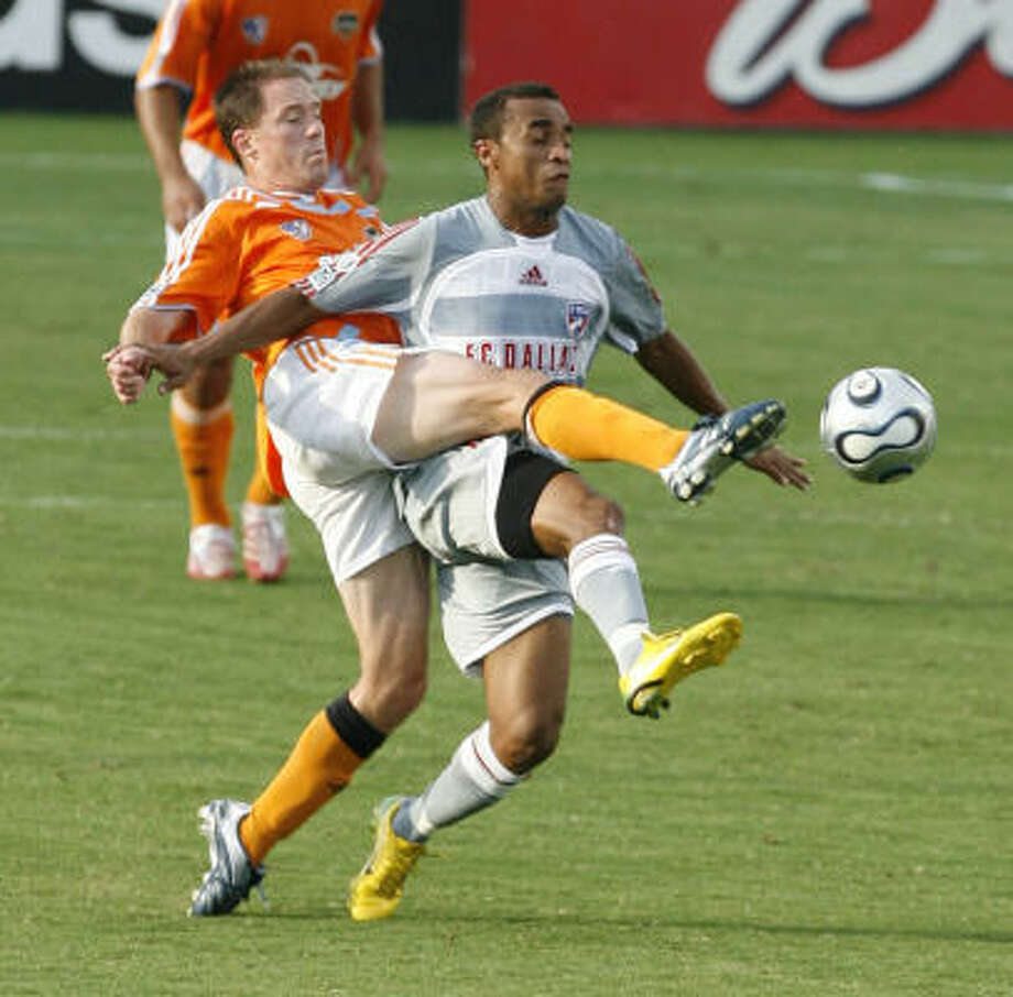 Richard Mulrooney (left) has helped the Dynamo compensate for the loss of Ricardo Clark. Photo: Billy Smith II, Chronicle