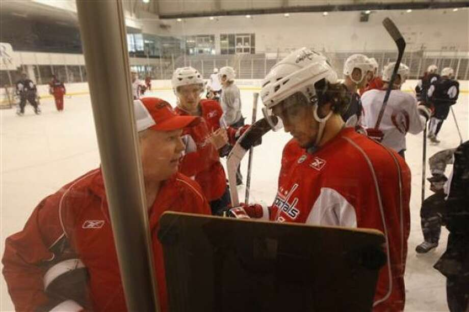 Bruce Boudreau (left), who was named interim coach of the Washington Capitals after Glen Hanlon was fired Thursday, conducts his first practice at Arlington, Va. Photo: Gerald Herbert, AP