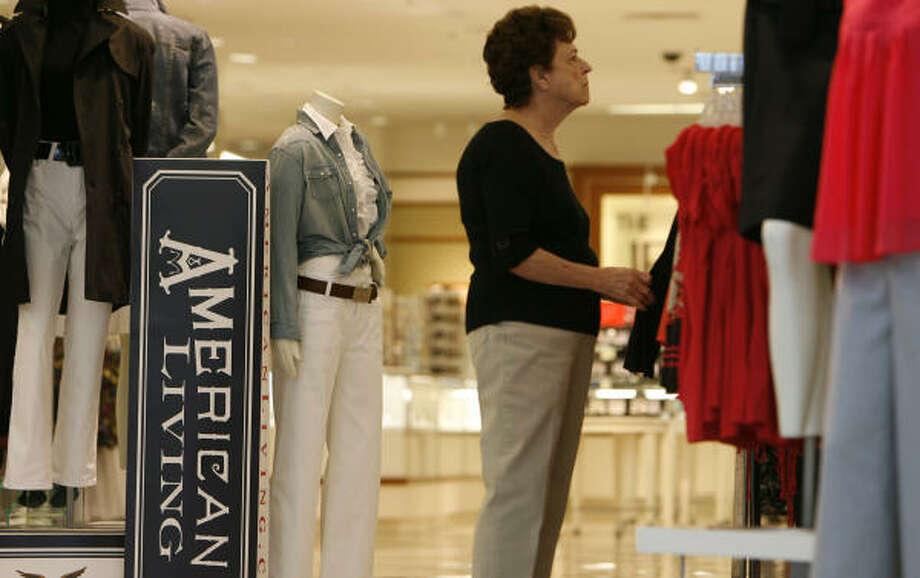 Wilma Watkins looks over women's wear in the J.C. Penney store in Memorial City Mall last week. Photo: James Nielsen, Chronicle