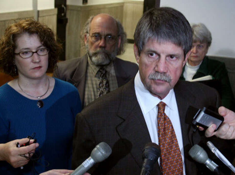 Jim Blackburn, attorney for groups opposed to coal power plants, center, praises the ruling blocking the governor's 2005 executive order creating a fast-track permitting process for coal-fired, electricity-generating plants. With him are Katrina Baecht, of Ravennah, and Public Citizen Texas Director Tom Smith. Photo: Jack Plunkett, AP