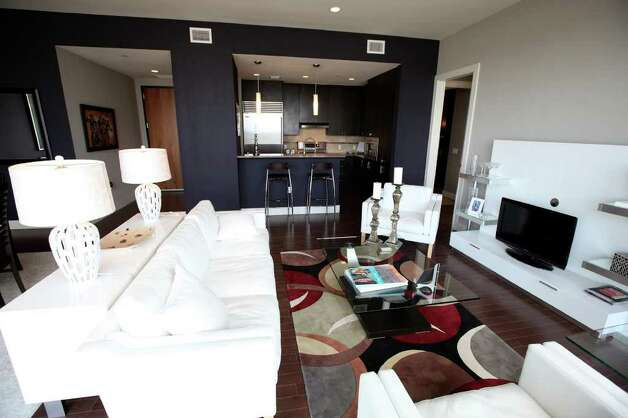 The living area of a condo at Alteza Luxury Residences in Downtown San Antonio is pictured July 12, 2011.   ANDREW BUCKLEY / abuckley@express-news.net Photo: ANDREW BUCKLEY, SAN ANTONIO EXPRESS-NEWS / abuckley@express-news.net