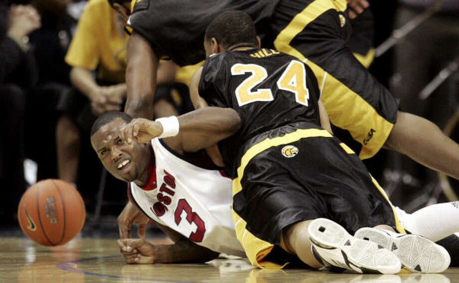 Robert McKiver had more than Southern Miss' Jarvis Hill on his back — he carried the Cougars with 28 points. Photo: Mark Humphrey, AP