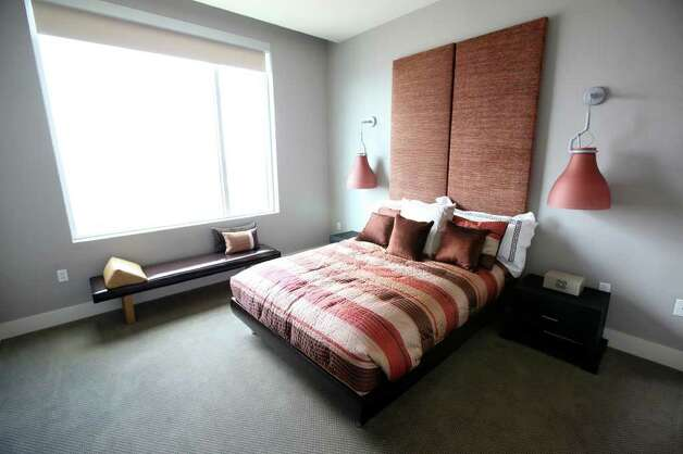 The bedroom of a condo at Alteza Luxury Residences in Downtown San Antonio is pictured July 12, 2011.   ANDREW BUCKLEY / abuckley@express-news.net Photo: ANDREW BUCKLEY, SAN ANTONIO EXPRESS-NEWS / abuckley@express-news.net