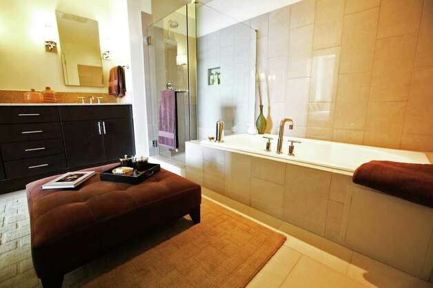The bathroom of a condo at Alteza Luxury Residences in Downtown San Antonio is pictured July 12, 2011.   ANDREW BUCKLEY / abuckley@express-news.net Photo: ANDREW BUCKLEY, SAN ANTONIO EXPRESS-NEWS / abuckley@express-news.net