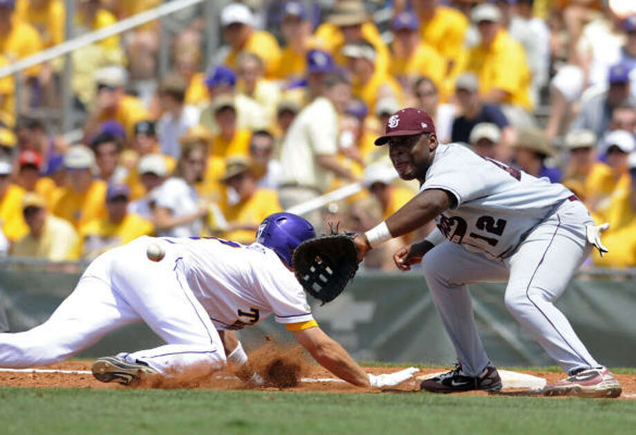 LSU's D.J. LeMahieu dives back to first as Texas Southern's Earnest Rhone reaches to catch the throw at the NCAA Baton Rouge Regional on Friday. LeMahieu was safe. LSU won 12-1. Photo: Liz Condo, AP