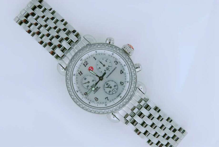 This Michele diamond bezel watch, with a retail value of $1,295, is among a dozen items donated by IW Marks for an in-store silent auction on Thursday to benefit the Berry family. Photo: IW Marks