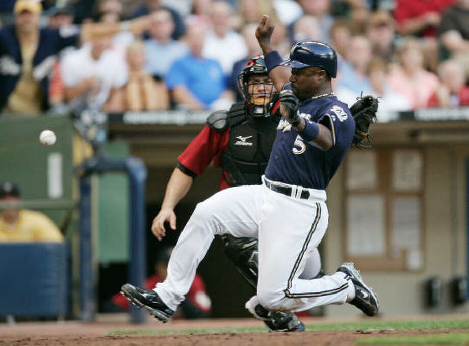 THIRD INNING: Ray Durham slides home safely as Astros catcher Humberto Quintero, rear, looks on. Photo: Jeff Hanisch, AP
